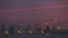 London Sunset silhouette red clouds with Canary Wharf Arkistovideo