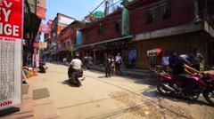 Crossroad in touristic disctrict Thamel, full of people and motorbikes. Nepal Stock Footage