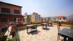 Roof of hotel with chairs and tables. Kathmandu, partly destroyed by earthquake Stock Footage