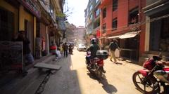 Walking along the street in Thamel district, Kathmandu, Nepal Stock Footage