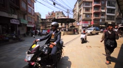 Kathmandu street, Thamel. Bikers cross the road. Nepal Stock Footage