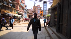 Walking along the street in Thamel district, Kathmandu, Nepal. Rickshaw's cycle Stock Footage
