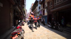 Men carry palanquin during Nepalese New Year celebration. Kathmandu Stock Footage