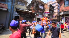 Men and kids carry palanquin during Nepalese New Year celebration. Kathmandu Stock Footage