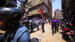 Group of children walks along the street, playing drums and cymbals. Kathmandu Stock Footage