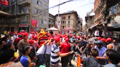 Street fight between drivers and men, who carry holiday palanquin with deity Stock Footage