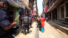 Police protects people at streets of Thamel during Nepal New Year celebration. Stock Footage