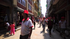 Children and adults play flutes and clap in during Nepal New Year. Kathmandu Stock Footage