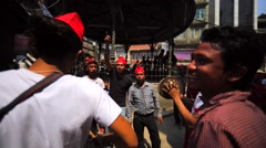 Group of men plays drums and cymbals at Kathmandu street at Nepalese New Year Stock Footage