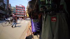 Store with a lot of different souvenirs at street market in Kathmandu, Nepal Stock Footage