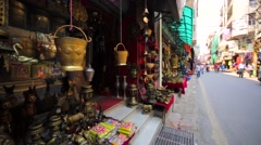 Stores with a lot of different souvenirs at street market in Kathmandu, Nepal Stock Footage