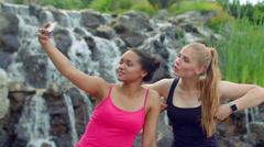 Girls selfie. Girlfriends taking selfie with smartphone outdoors. Selfie women Stock Footage