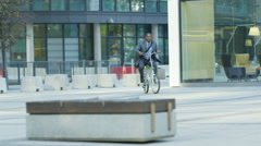 4K African American businessman cycling in the city Stock Footage