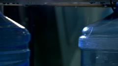 Bottle being filled by water. Stock Footage
