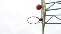 Old basketball hoop sport bottom view outdoors rusty iron ball enters the basket Stock Footage