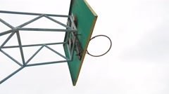 Old basketball hoop outdoors rusty iron ball sport enters the basket Stock Footage