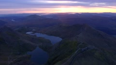 Aerial view down towards mount Snowdon at dawn. Stock Footage