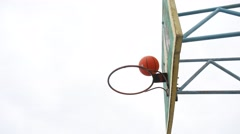 Sport old hoop basketball bottom view outdoors iron rusty ball enters the basket Stock Footage