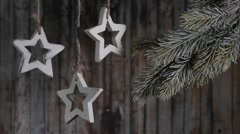 Christmas garland of wooden stars on the background of the old wooden planks. Stock Footage