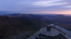 Slow aerial orbit of the summit of Snowdon at dawn. Stock Footage