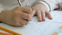 Pupil writes the text in a workbook with a pen Stock Footage