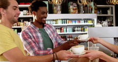 Waitress serving cup of coffee to customer Stock Footage