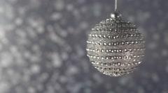 Beautiful diamond Christmas ball on a silver background bokeh. Stock Footage