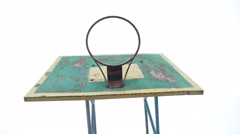 Old basketball hoop outdoors rusty sport iron ball enters the basket Stock Footage