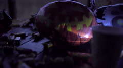 Table decorated with halloween symbol - jack o'lantern, skeleton, witch hat Stock Footage
