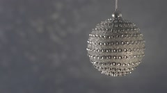 Beautiful diamond Christmas ball on a silver background bokeh. Stock Footage