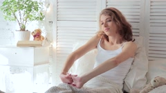 Morning of young attractive woman. She woke up and stretching after sleeping Stock Footage