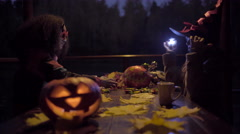 Two teen girls sharing candys after trick or treat on Halloween night Stock Footage