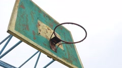 Old basketball hoop outdoors rusty iron ball enters the basket Sports Stock Footage