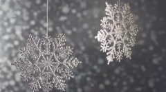 Silver diamond sparkling snowflakes on a silver background bokeh. Stock Footage