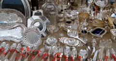 Vintage tableware silver objects at a flee market Stock Footage