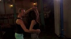 Couple dancing, woman's long brown hair flying, slowmo Stock Footage