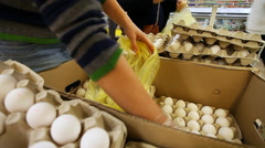 Woman buys eggs at the supermarket Stock Footage
