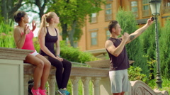Young people taking selfie with phone at park in summer. Happy friends Stock Footage