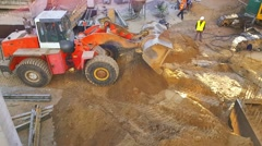 Tractor on construction site aligns ground Stock Footage