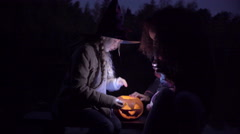 Two teenagers playing with lights on Halloween night Stock Footage