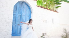 Wedding photo. Happy bride outdoor photo shooting at streets Stock Footage