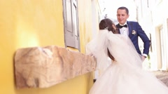 Wedding photo. Happy bride and groom together outdoor photo shooting at streets Stock Footage