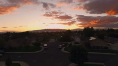 Lift from the ground to the sky overlooking neighbor hood at sunset from above Stock Footage