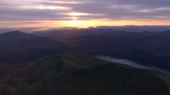 Aerial view of Snowdonia at sunrise with fog in the valleys. Stock Footage