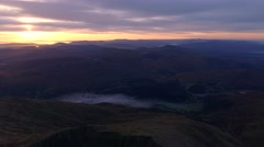 Aerial view of snowdonia at sunrise with mist in the valleys. Stock Footage