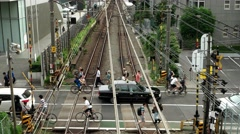 Tokyo - People and traffic at small railway crossing. 4K resolution. Stock Footage