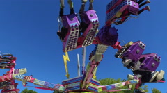 Fall Fair Medium wide static shot of ride spinning people in the air Stock Footage