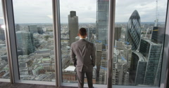 4K Young successful business executive looking out at view of the city Stock Footage