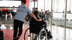 Passengers in a Gate in an Airport. Disabled person on a wheelchair. Stock Footage