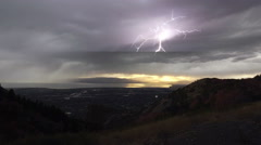 Storm working across valley as lightning strikes as the rain follows Stock Footage